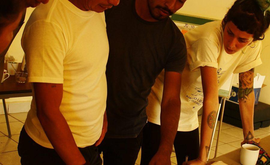 """Graphic designer working with community facilitators and their coordinator on development of popular educational materials, Jaltenango, Chiapas, Mexico (2018). Photo:  Alejandra Guzmán Luna"