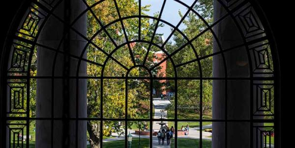 view of campus through arched window in Waterman Building