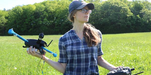 Lindsay Barbieri prepares to fly a drone.
