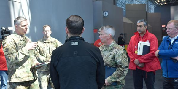 army corps engineers standing in Javits Center talking