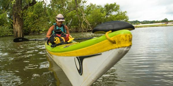 Maya Dizack paddles on the Mississippi River