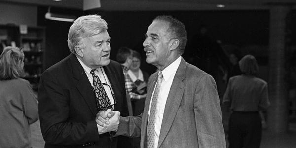 Then-president of UVM Tom Salmon and Lawrence McCrorey shaking hands.