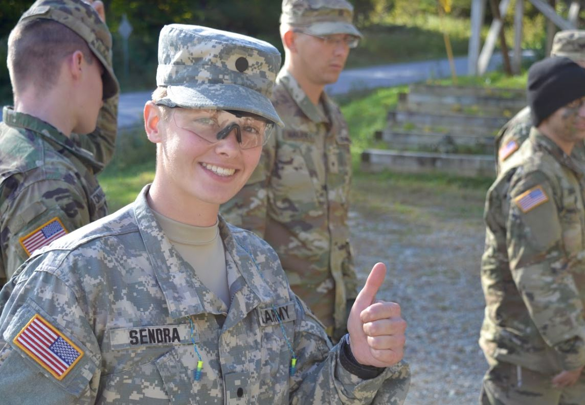 Female cadet gives a thumbs up