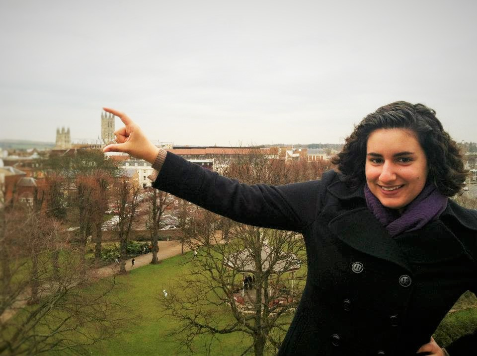 Student poses with the cathedral in the background