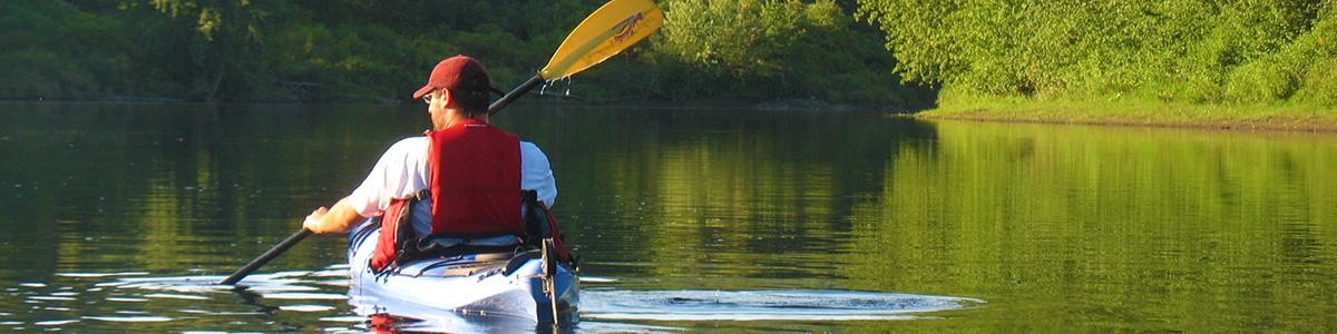 Man paddling in a kayak on river