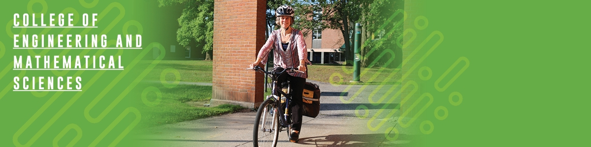 Lisa Altman-Hall biking on the UVM campus