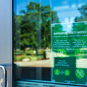 Image of a safety reminder sign on the exterior door to the Davis Center
