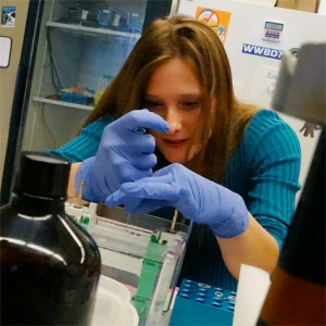 Student using pipette in lab
