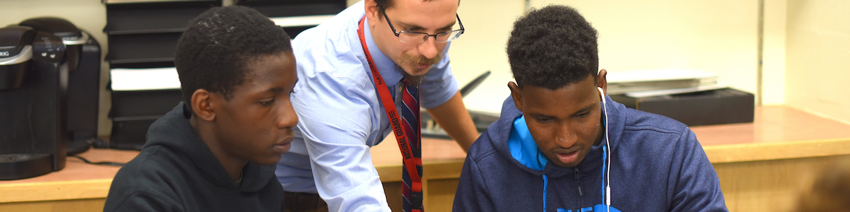 Tom Payeur teaching math with students at Winooski High School.