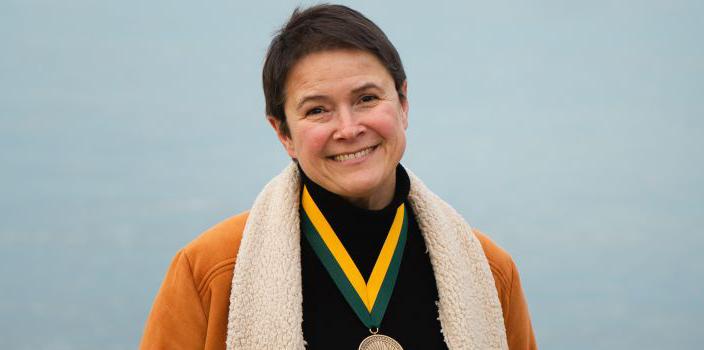 Cristina Mazzoni by lake champlain wearing a medal