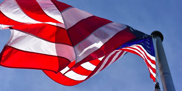 an american flag waiving in the wind