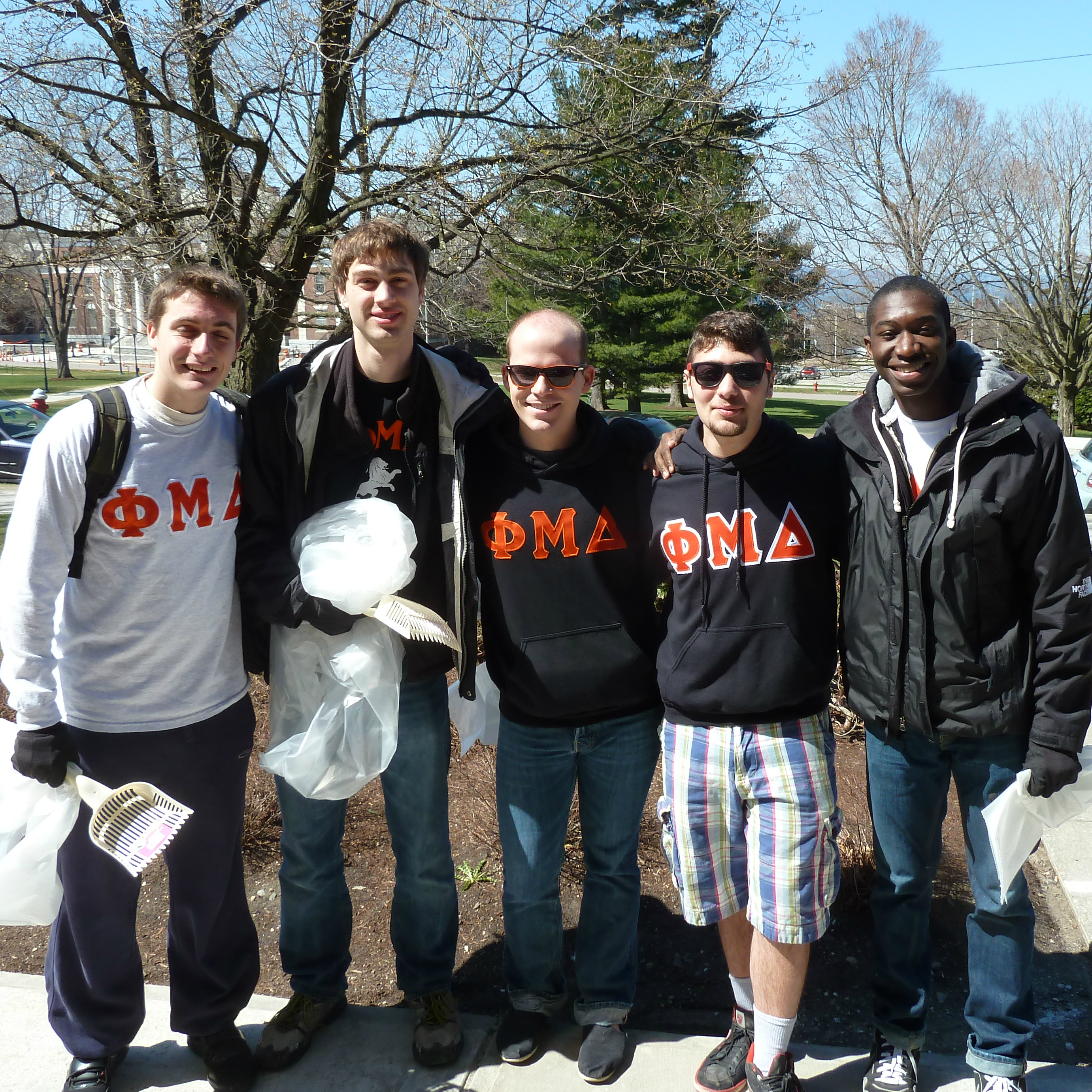 Members of UVM Fraternity and Sorority life doing a community clean-up