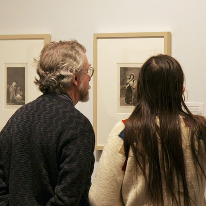 Image of guests viewing prints by Goya