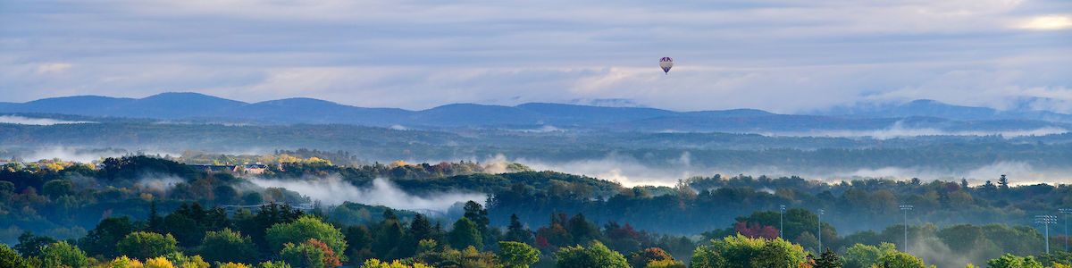 Photo of Green Mountains and floating hot air balloon