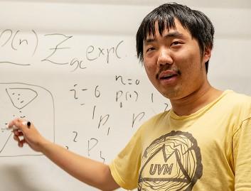 Jiangyong Yu in front of whiteboard