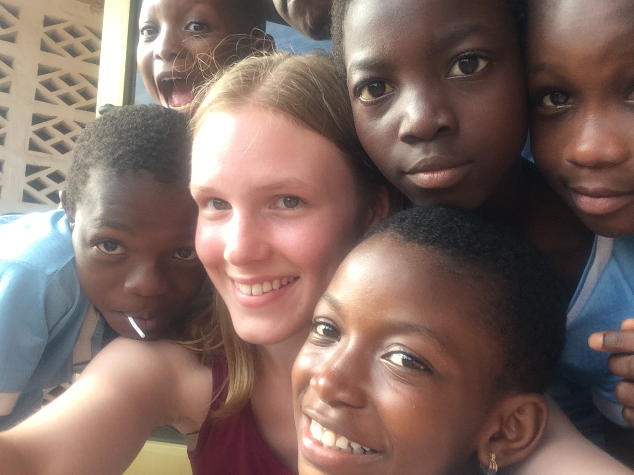 Kisseman poses with African children