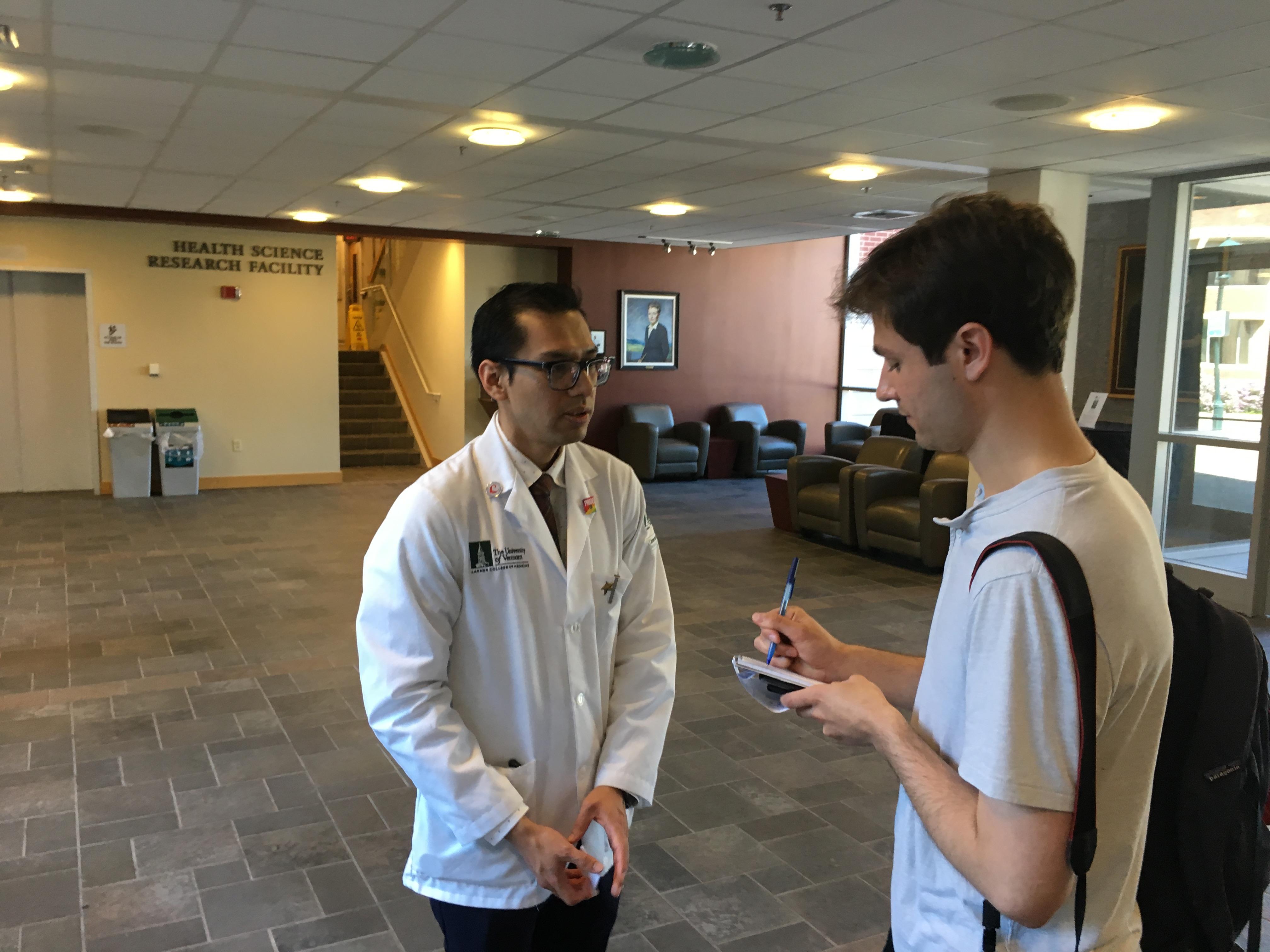 Student reporter Luke Zarzecki interviews Juan Conde.