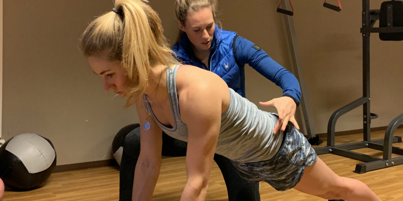 Regan Dewhirst guides Mikaela Shiffrin through core strength and stabilization exercises