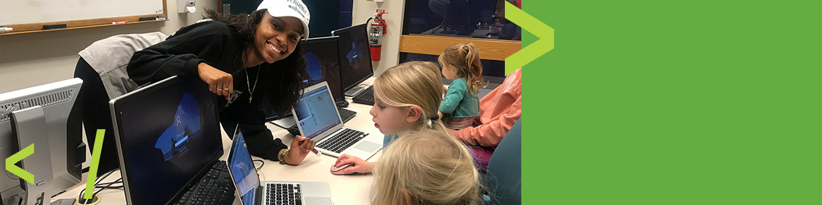 Student Nikki Allen tutors elementary school girls to code
