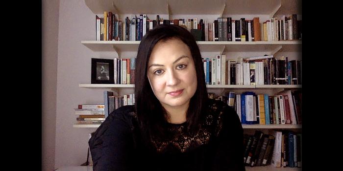 Sarah Alexander, dark hair and eyes, looking into camera