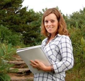 Meg Sodano holding her sketchbook