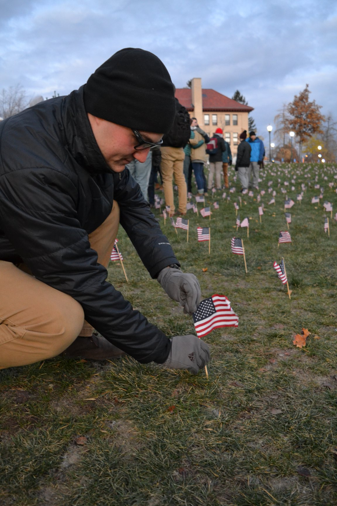 Cadet Smetank plants flags to honor the fallen.