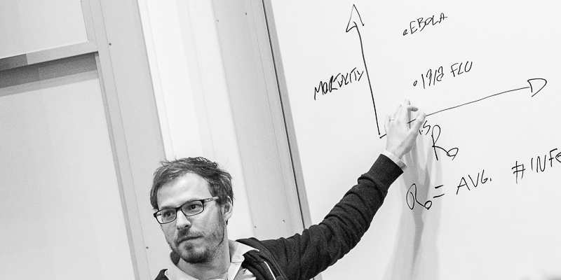 Hébert-Dufresne standing at the white board
