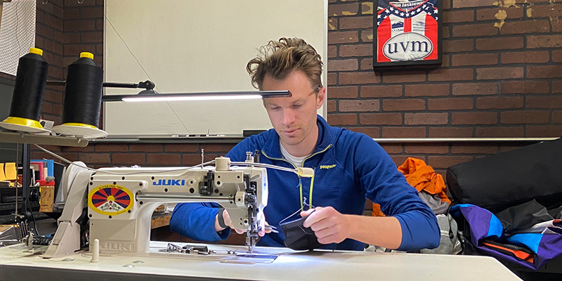 Alumnus Colin Jaskiewicz sews a prototype medical mask at Orucase headquarters in San Diego