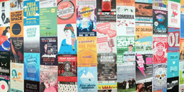 a wall of posters designed by students
