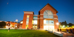 exterior shot of the davis center at night