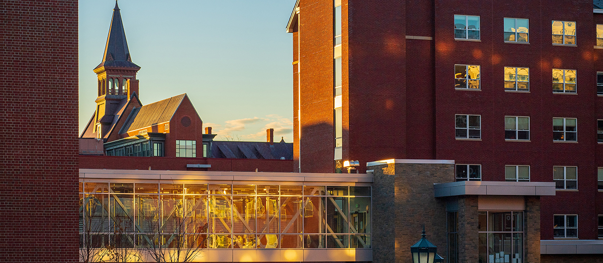 UVM's Old Mill and Central Campus Residence Hall at golden hour