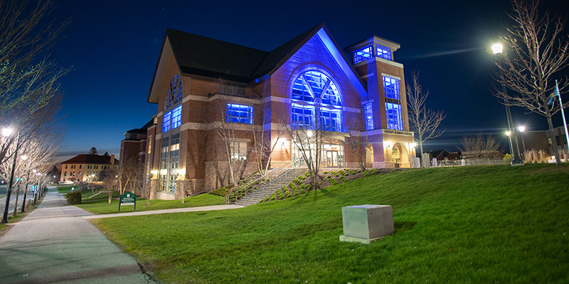 The Davis Center, lit up to honor frontline workers