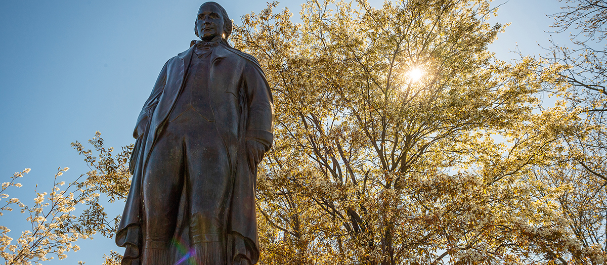 Statue of Ira Allen at University of Vermont in spring
