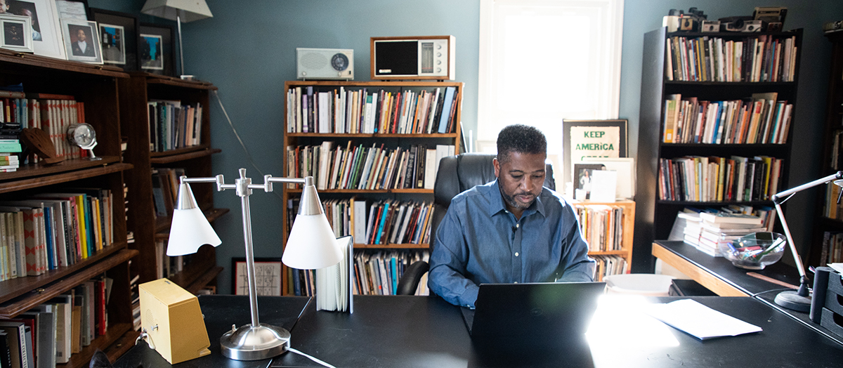 Poet Major Jackson works on his computer in home office