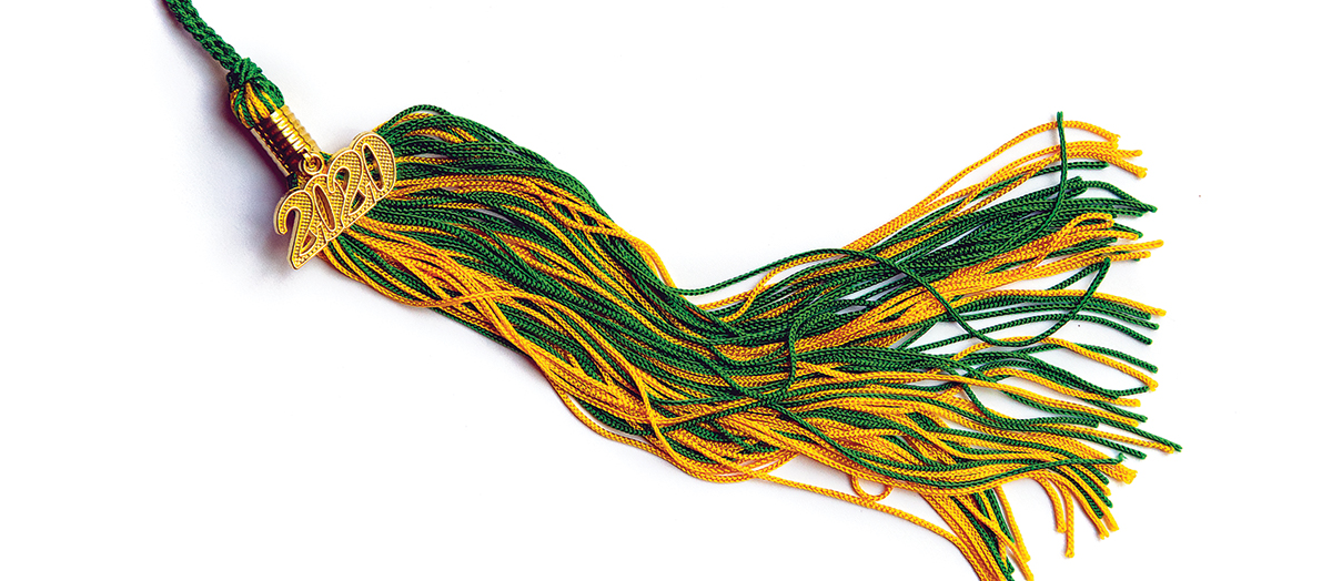Green and gold UVM graduation tassel with 2020 charm attached