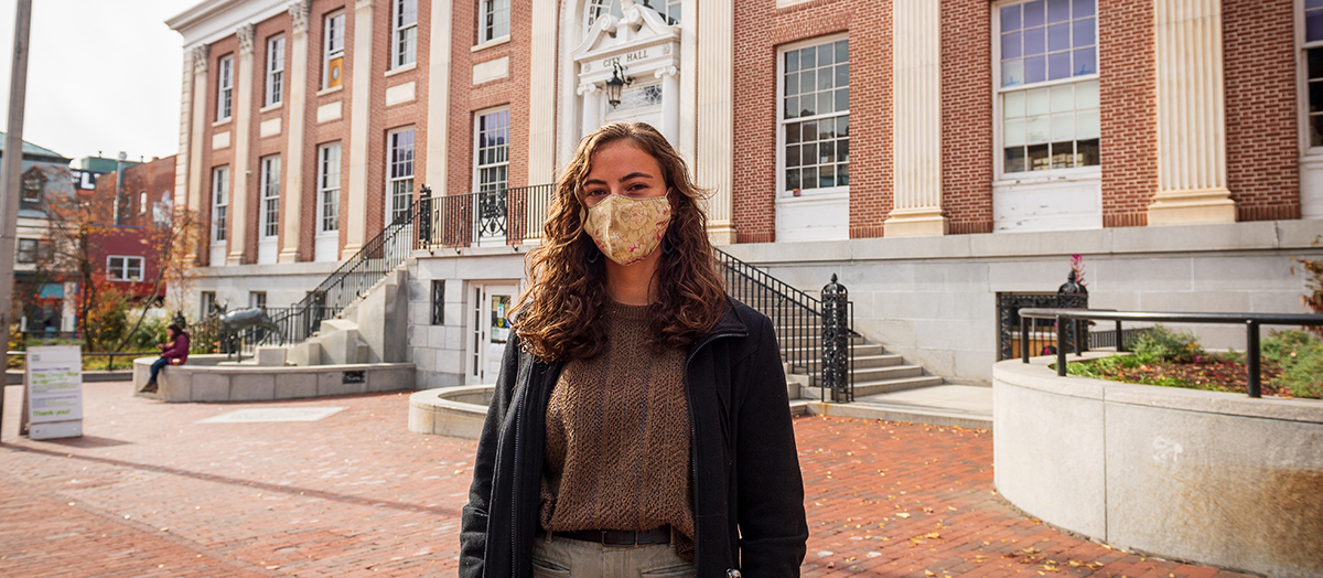 UVM senior Valentina Czochanski in front of Burlington City Hall