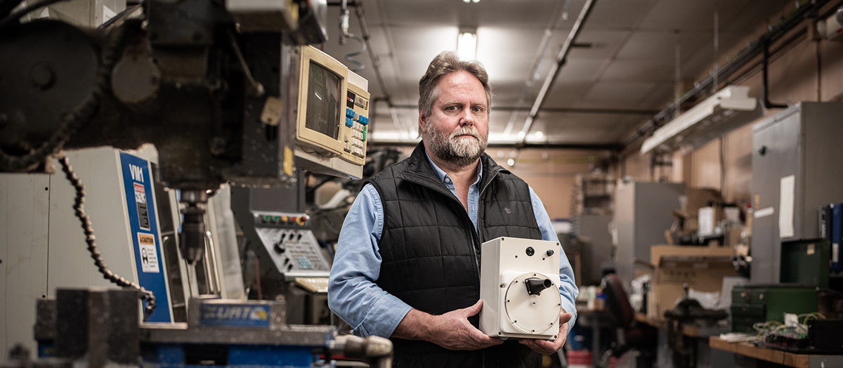 Carl Silver, engineer in UVM's IMF labs, holds Vermontilator emergency ventilator