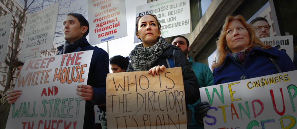 Kaitlyn Vitez '15 holds sign alongside protestors