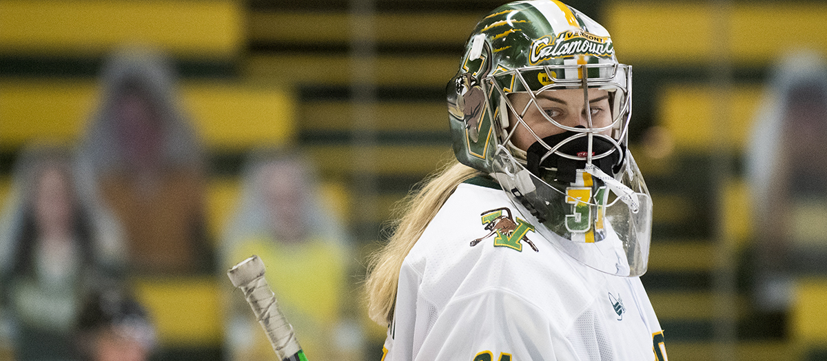 UVM women's hockey goaltender Blanka Škodová in double masks