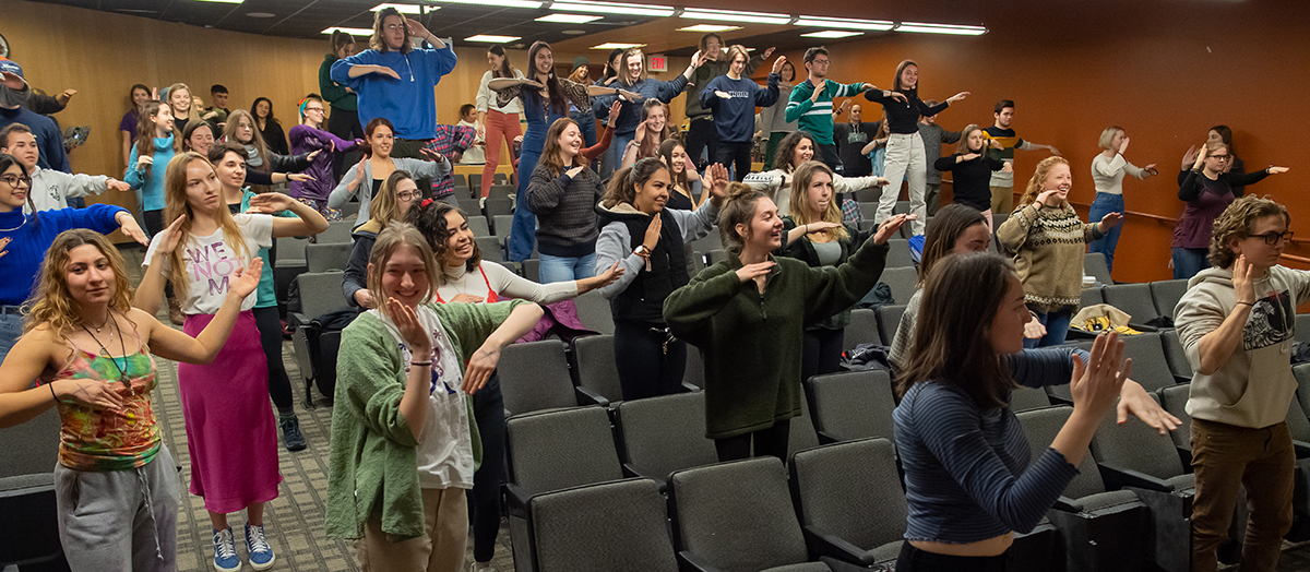 Students dance standing in lecture hall in UVM's Fleming Museum