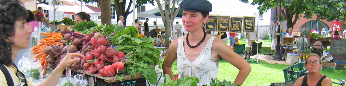 Woman buying radishes at farmer's market
