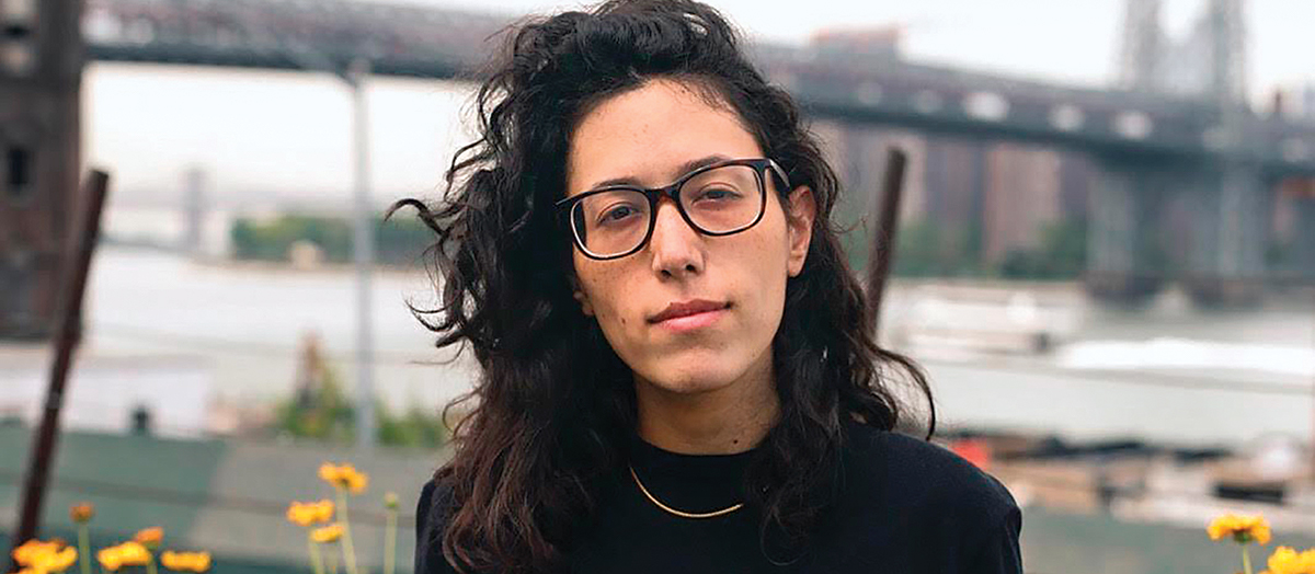 UVM alumna Ariel Wengroff in front of a bridge