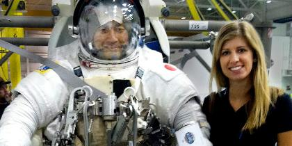 Karina Marshall-Goebel '10 with astronaut in space suit