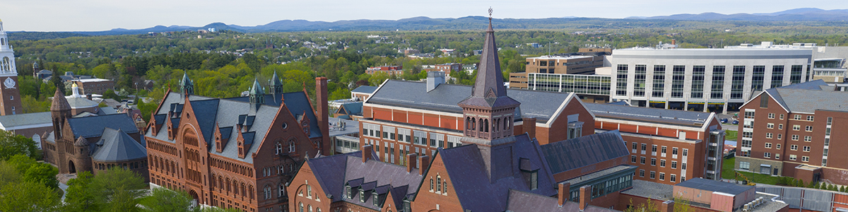 Drone image of campus buildings and mountains beyond