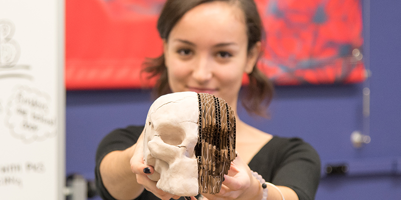 Claudia Benito Alston holding a skull she created in the Fab Lab at UVM