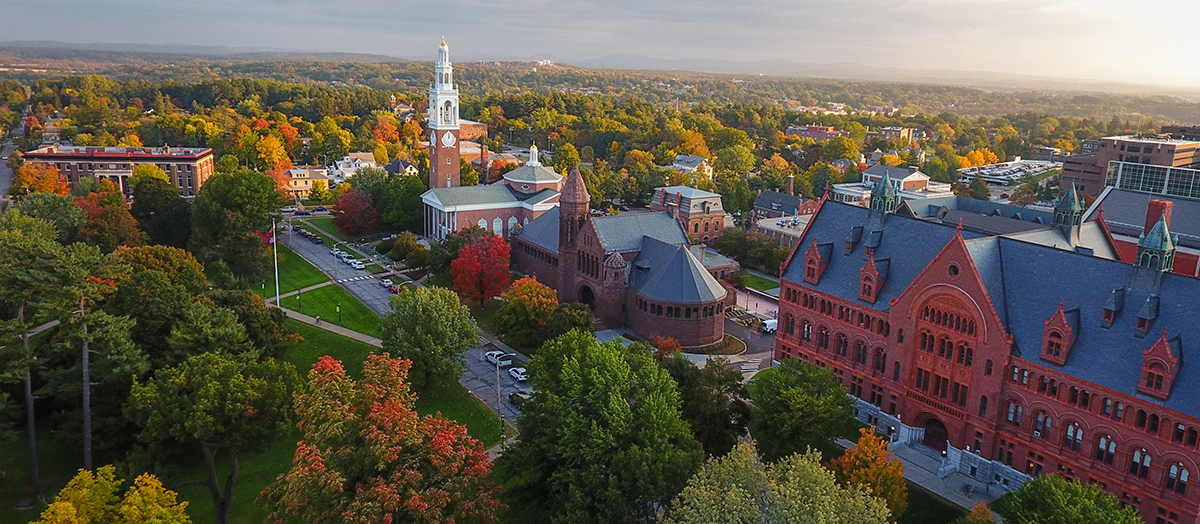 An aerial view of UVM Green and Historic row, dotted with fall foliage