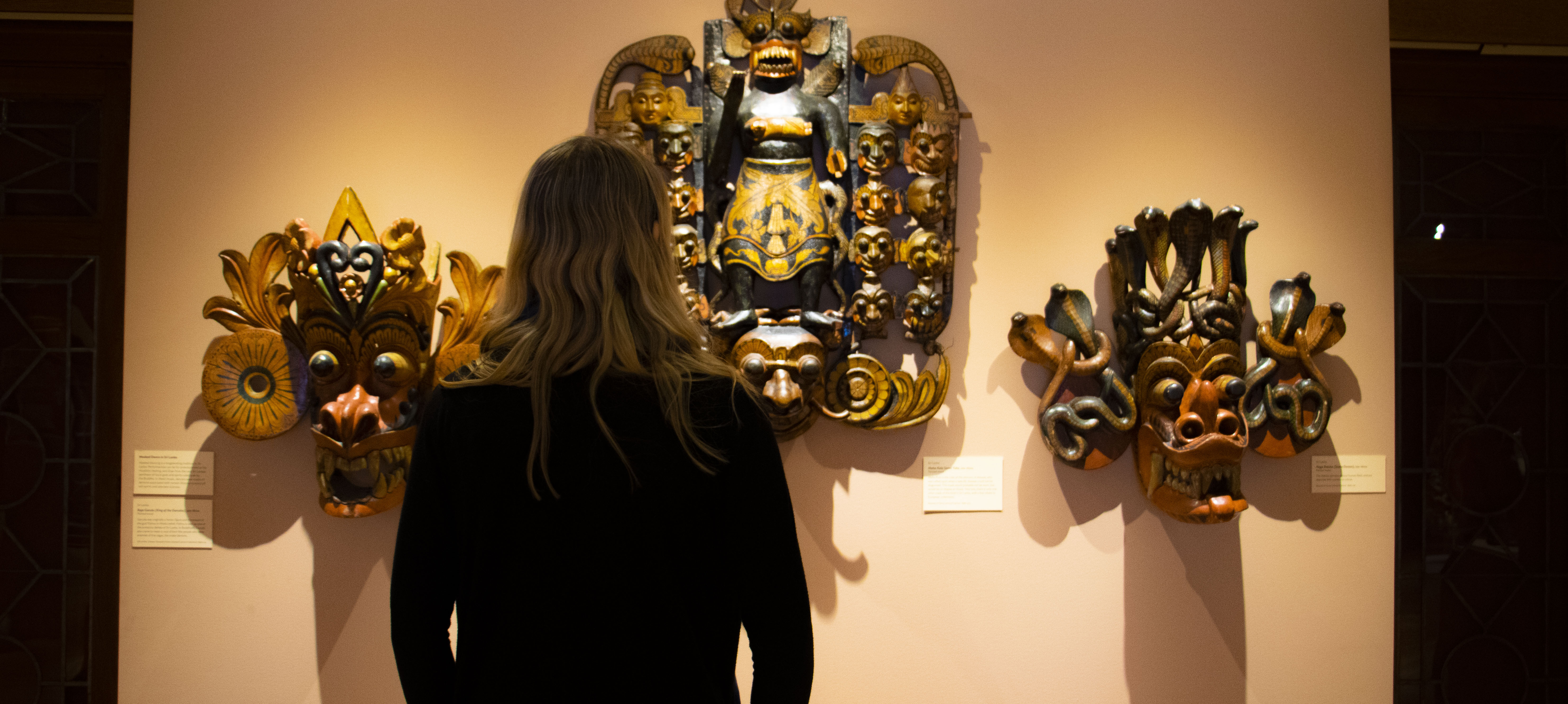 Senior Halley Malloy observes the South Asia exhibit at the Fleming Museum