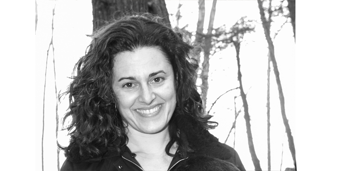 Hilary Neroni, smiling at camera, image is black and white