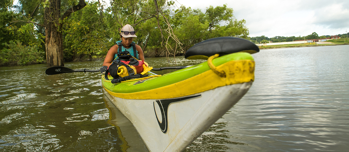 Student Maya Dizack in kayak on Mississippi River