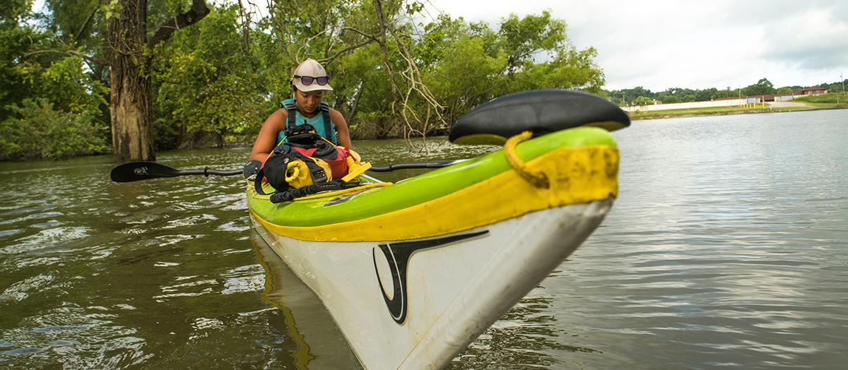 Student Maya Dizack in kayak on Mississippi River